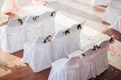 Wedding chair covers with flowers Royalty Free Stock Image