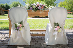 Wedding Chair Covers with Fresh Roses Royalty Free Stock Photography