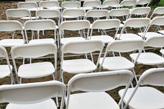 Wedding chairs. Outside wedding chairs preparing for a beach celebration stock images
