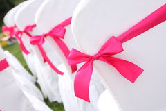 Wedding chairs. Ribbon decoration on wedding chairs cover Stock Photography