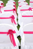 Wedding chairs. Ribbon decoration on wedding chairs cover Royalty Free Stock Image
