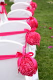 Wedding chairs. Ribbon decoration on wedding chairs cover Stock Photos