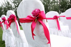 Wedding chairs. Ribbon decoration on wedding chairs cover Royalty Free Stock Images