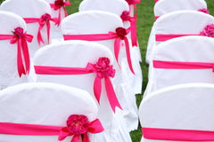 Wedding chairs. Ribbon decoration on wedding chairs cover Royalty Free Stock Photo