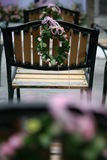 Wedding chairs 2. Wedding bouquet and wooden chairs Stock Image