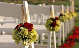 Wedding Chairs. Wedding Ceremony Chairs with Flowers Hanging Stock Photos