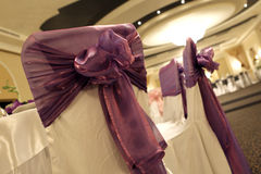 Wedding chairs. With mauve bows Stock Photo