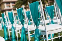 Wedding chairs. With blue ribbon stock image