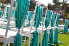 Wedding chairs. With blue ribbon Royalty Free Stock Images
