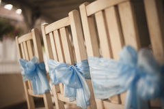 Wedding chairs decorated in blue color Royalty Free Stock Photography