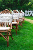 Wedding chairs decorated with flowers. Close up. Royalty Free Stock Images