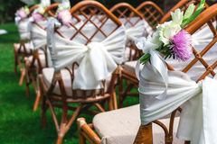 Wedding chairs decorated with flowers. Close up. Stock Photos