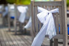 Wedding chairs decorated with white bows at Stock Images
