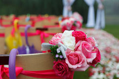 Wedding chairs and flowers. Bunch of flowers and chairs at wedding ceremony scene stock images