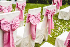Wedding chairs with pink bows Royalty Free Stock Images