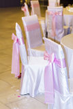 Wedding chairs with pink ribbons Royalty Free Stock Photography