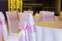 Wedding chairs with pink ribbons Royalty Free Stock Photo