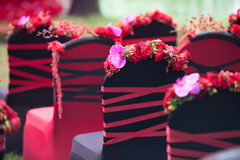Wedding chairs. The red bouquet decorated in wedding bench Stock Photo