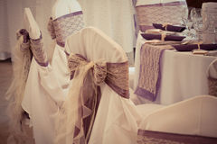 Wedding chairs with ribbon Stock Images