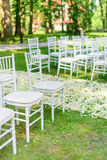 Wedding chairs set up before the ceremony Stock Photo