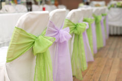 Wedding chairs with silk ribbon Royalty Free Stock Photography