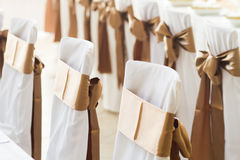 Wedding chairs with silk ribbons Stock Photos