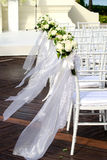 Wedding Chairs. White Wedding Chairs with beautiful flower Royalty Free Stock Photography