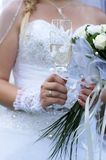 Wedding champagne glass. The bride holds a beautifully decorated glass of champagne Royalty Free Stock Photography
