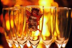 Wedding champagne glass Angel studio. Gold bokeh royalty free stock photos