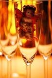 Wedding champagne glass Angel studio. Gold bokeh royalty free stock image