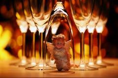 Wedding champagne glass Angel studio. Gold bokeh stock images