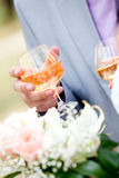 Wedding champagne by the glass in the hands of new Royalty Free Stock Image