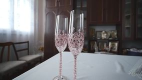 Wedding champagne glasses on table.  stock video