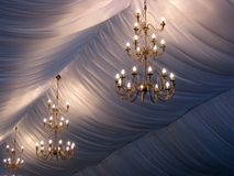 Wedding chandeliers. Illuminated chandeliers for a wedding Stock Photos