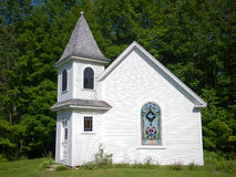 Wedding Chapel. A small chapel on the side of a backroad in New Hampshire with stained glass, white clapboard exterior an a steeple royalty free stock photos