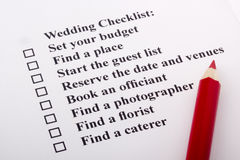 Wedding Checklist. Red pencil laying on a wedding checklist Stock Images