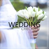 Wedding Checklist. Beautiful wedding bouquet in hands of the bri Stock Photo