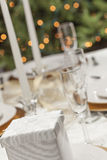 Wedding or Christmas Gift at Place Setting on Elegant Table Stock Photos