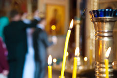 Wedding in a church. With burning candles Stock Photo