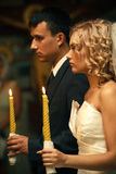 Wedding in church. The bride and groom on ceremony of wedding - internal church Royalty Free Stock Image