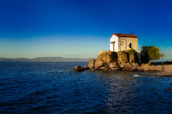 Wedding church at the seaside. Lesvos. Greece. This lovely chapel is situated in small Greek village of Skala Sykaminias, Lesvos island. Postcard from Greece stock image