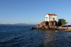 Wedding church at the seaside. Lesvos. Greece. This lovely chapel is situated in small Greek village of Skala Sykaminias, Lesvos island. Postcard from Greece stock photo