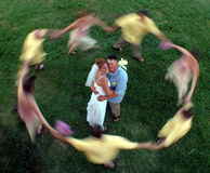 Wedding circle. Movement of a circling bridal party creates a blur around a bride and groom Stock Image
