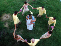 Wedding circle. A bridal party circles a bride and groom royalty free stock photos