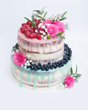 Wedding Color Drip Cake With Roses, Blueberries And Raspberries Royalty Free Stock Images