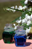 Wedding Colored Water. This is actually a wedding tradition where the bride and groom each have their own colored water. In the ceremony, they mix the water Stock Photo