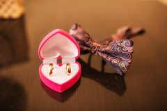 Wedding composition of attributes. Wedding rings and vintage bow tie Stock Images