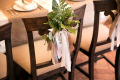 Wedding composition of the green on a chair. Stock Photography