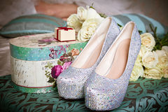 Wedding composition set-up with bridal shoes, giftbox and roses Royalty Free Stock Image