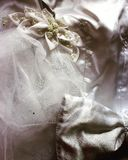 Wedding composition. White bride with a bow and a white veil bride with pearl on a white background Royalty Free Stock Images
